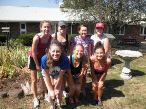 Hannah, Whitney, Tailor, Lara, Jancee, Lauren and Morgan weeding at Manor Care!